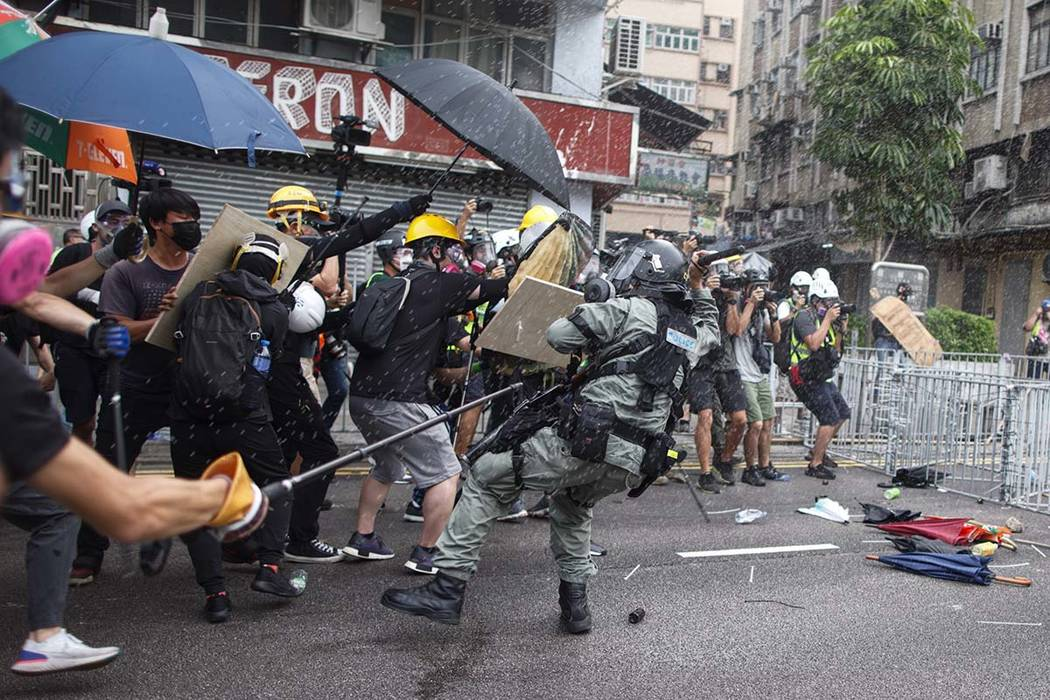 Protesters clash with police in Yuen Long district in Hong Kong on Saturday, July 27, 2019. Pol ...