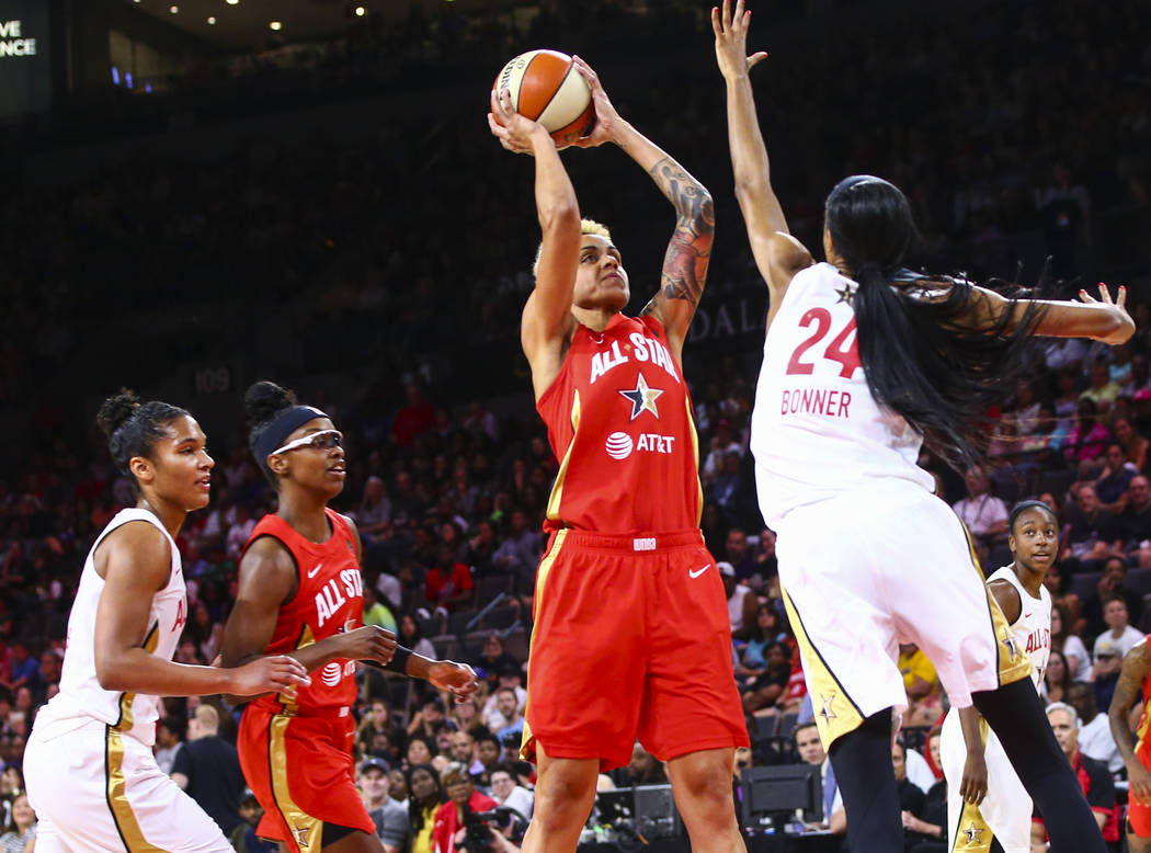Indiana Fever's Candice Dupree shoots over Phoenix Mercury's DeWanna Bonner during the second h ...