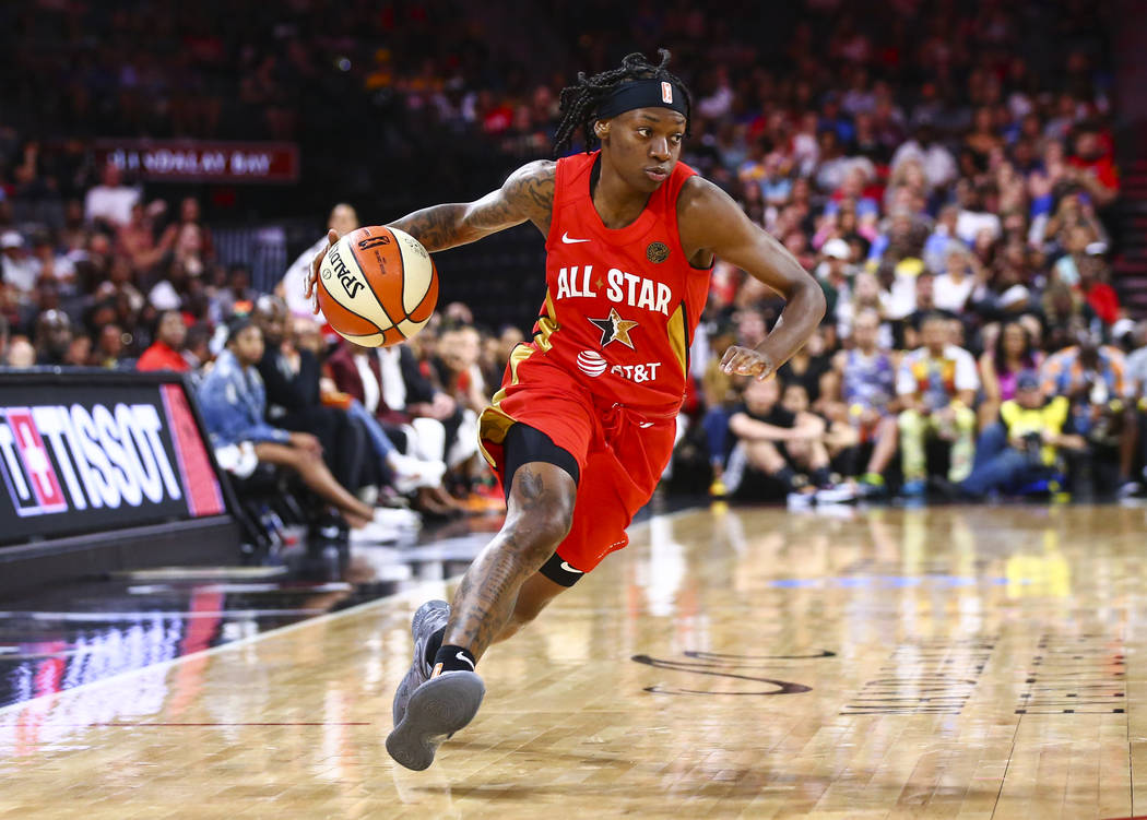 Indiana Fever's Erica Wheeler drives to the basket during the second half of the WNBA All-Star ...