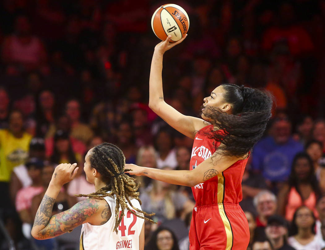 Las Vegas Aces' Liz Cambage shoots over Phoenix Mercury's Brittney Griner (42) during the first ...