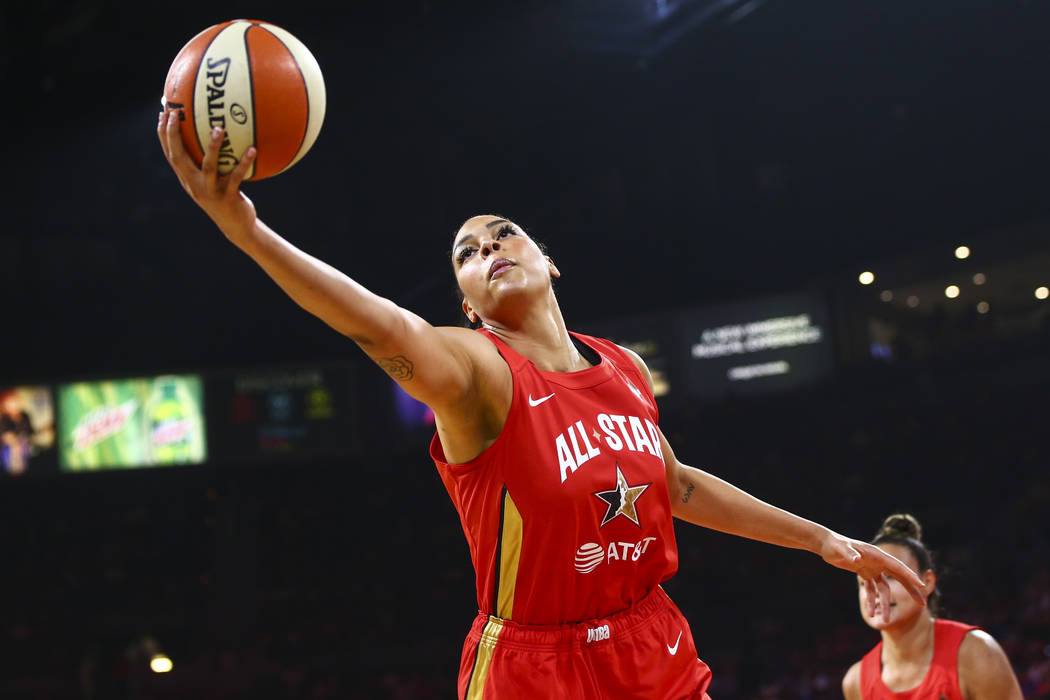Las Vegas Aces' Liz Cambage gets a rebound during the first half of the WNBA All-Star Game at t ...