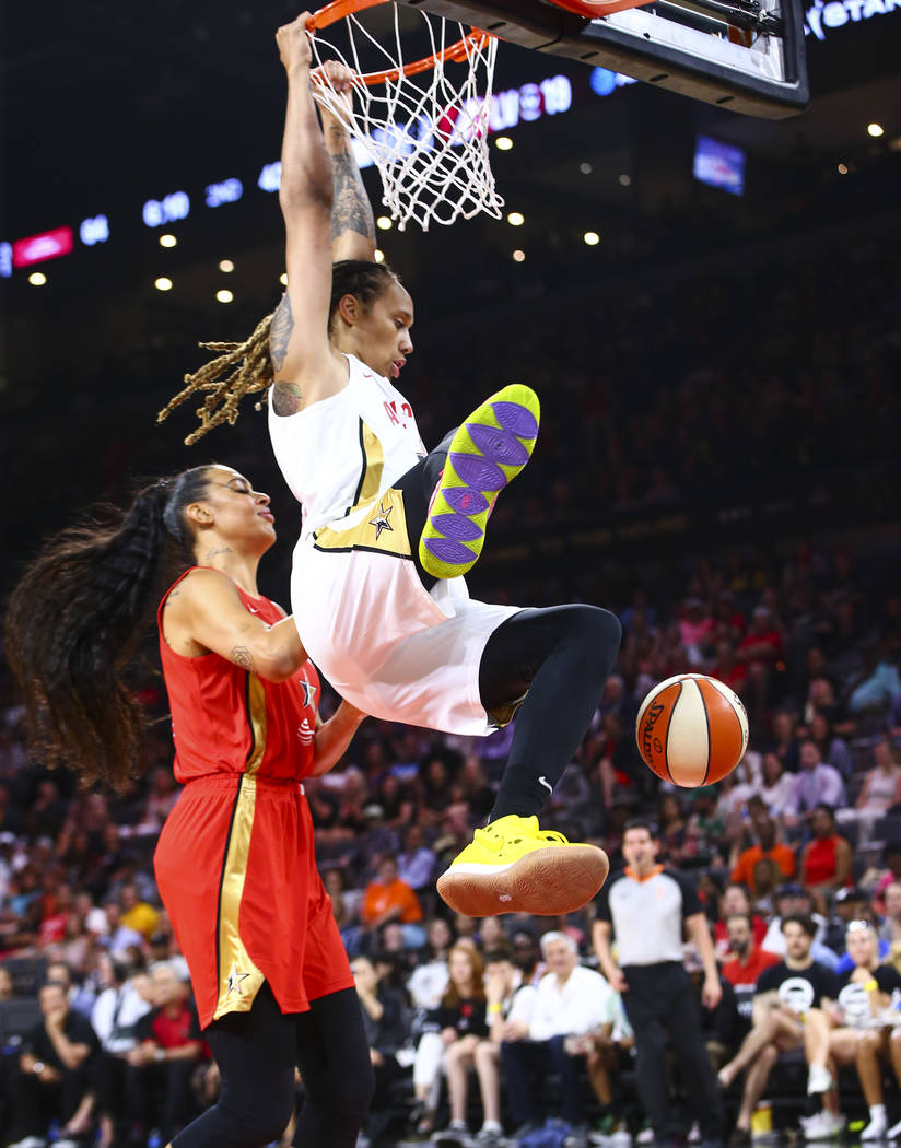 Phoenix Mercury's Brittney Griner dunks in front of Las Vegas Aces' Liz Cambage during the firs ...
