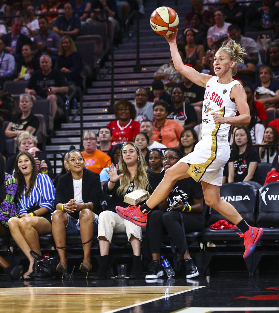 Chicago Sky's Courtney Vandersloot jumps to keep the ball in during the second half of the WNBA ...