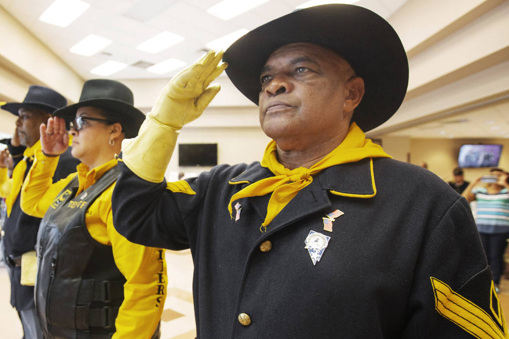 Mitchell Sayles, right, Tiffany Barnett and Kelly Hawthorne salute during Buffalo Soldiers Day ...