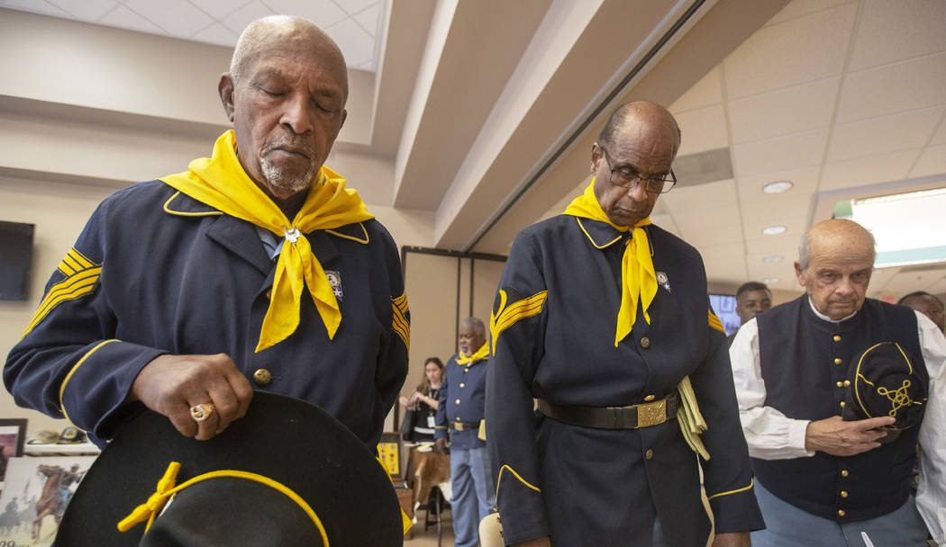 Buffalo Soldier members William Crenshaw, left, Ollie Henry and Fred Hampton pray during Buffal ...