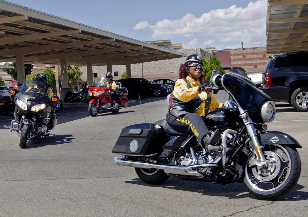 Buffalo Soldiers motorcyclist Judy Ann Young, right, pulls into Doolittle Senior Center for Buf ...