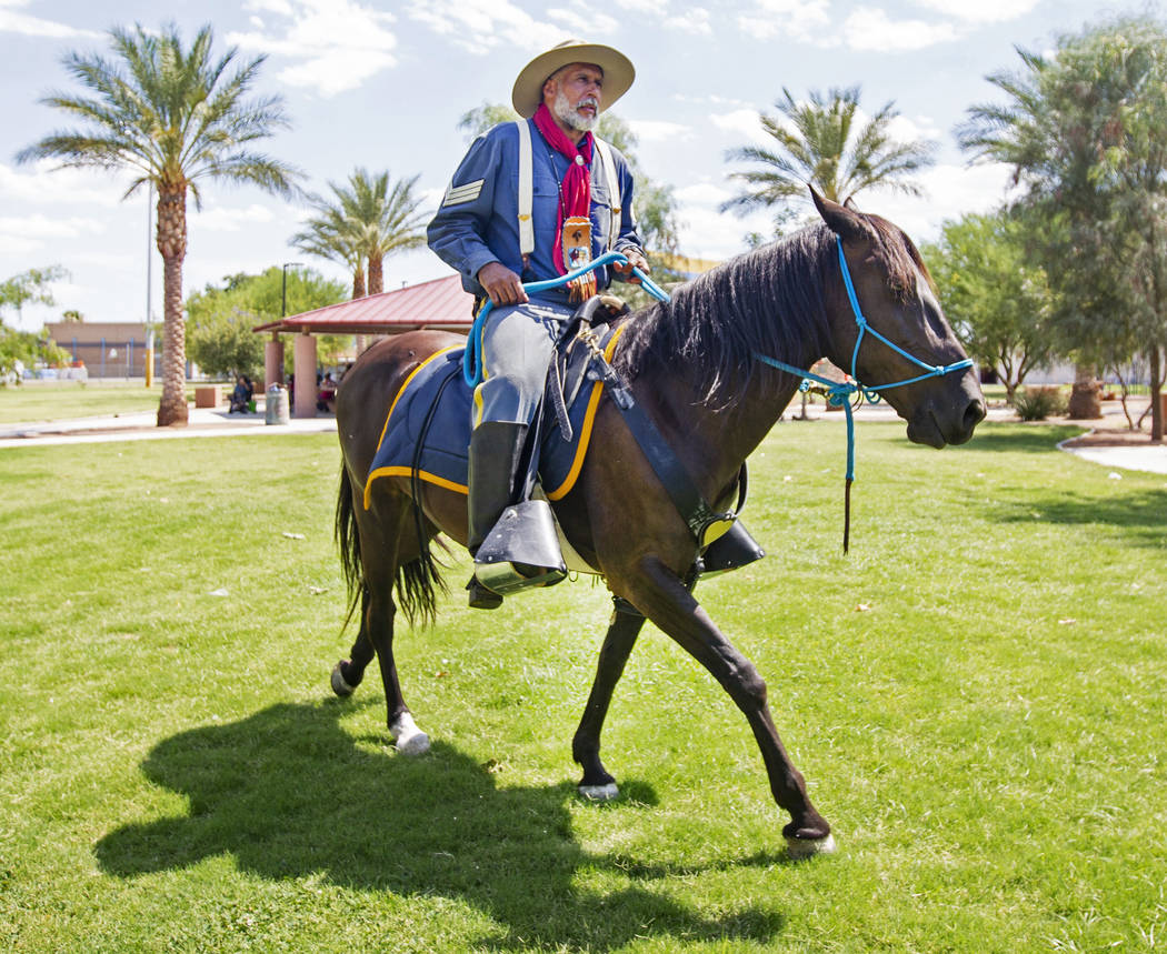 Keith Hill,president trooper of the 9th and 10th Horse Cavalry Association,rides hi ...