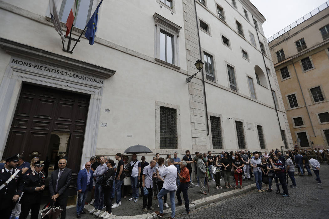 People line up to pay respect in the church where Carabinieri officer Mario Cerciello Rega was ...
