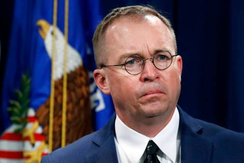 FILE- In this July 11, 2018, file photo Mick Mulvaney, listens during a news conference at the ...