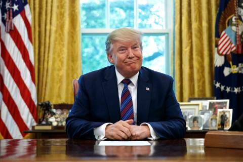 President Donald Trump pauses as he speaks in the Oval Office of the White House in Washington, ...