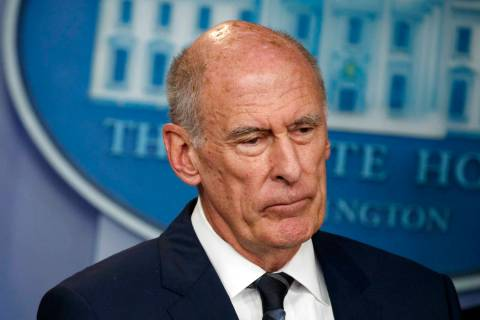 FILE - In this Aug. 2, 2018, file photo, Director of National Intelligence Dan Coats listens du ...
