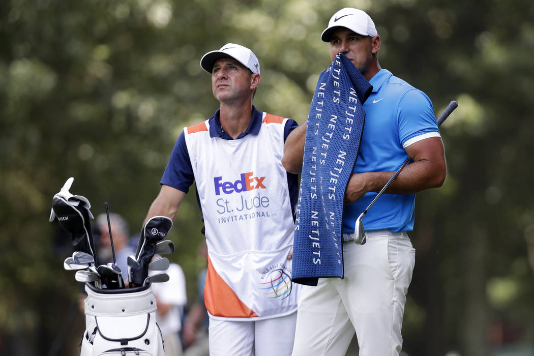 Brooks Koepka prepares to hit on the third fairway during the final round of the World Golf Cha ...