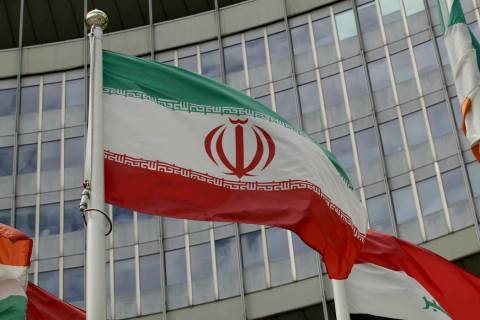 The Iranian flag waves outside of the UN building that hosts the International Atomic Energy Ag ...