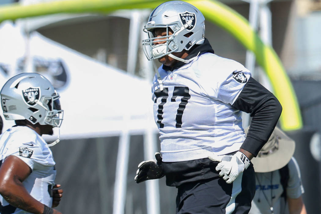 Oakland Raiders running back Jalen Richard (30) and offensive tackle Trent Brown (77) run past ...