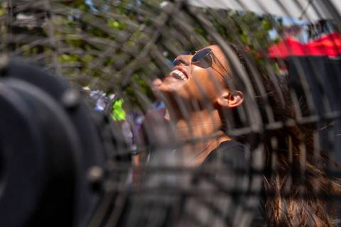 Sapir Partush from Israel cools off from the heat in a fan outside of the L'Core Paris beauty s ...
