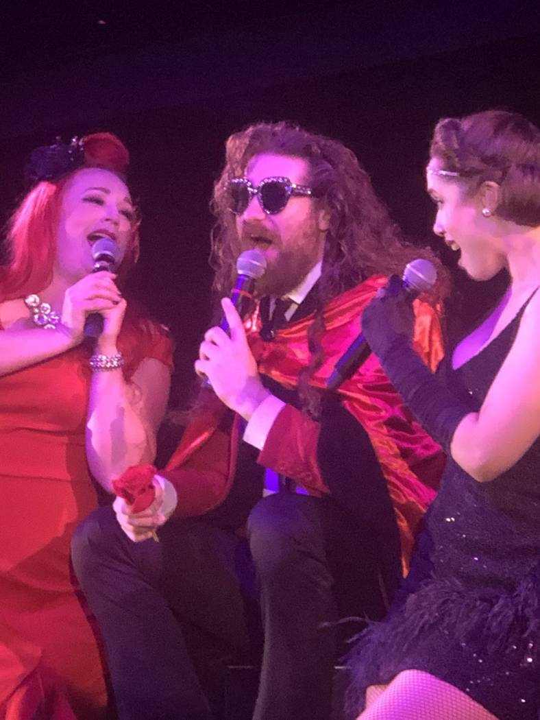 Casey Abrams, flanked by Dani Armstrong, left, and Jaclyn McSpadden, perform during the finale ...