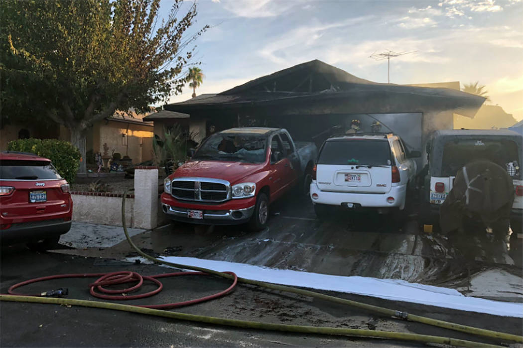 Crews battle a fire at a home in the 600 block of Watkins Drive in Las Vegas on Sunday, July 28 ...