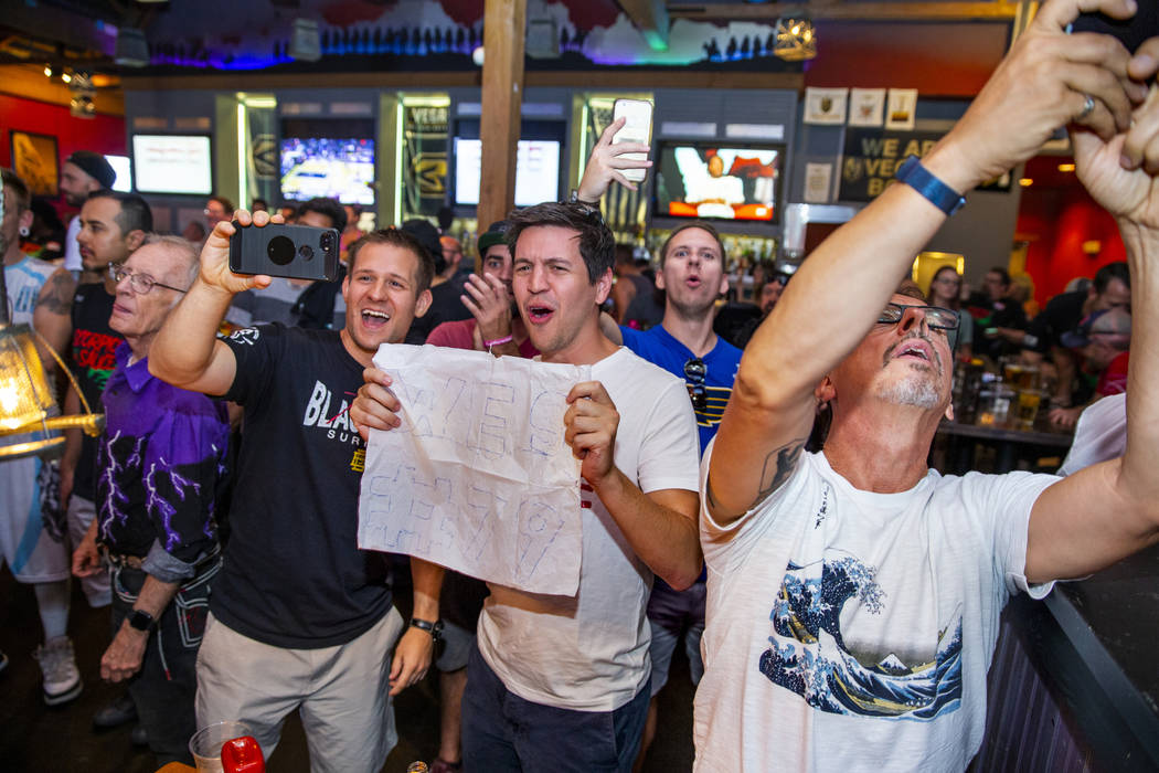 Friends of competitor Wes Davis cheer for him during his round as PT's Ranch hosts a $4,000 win ...