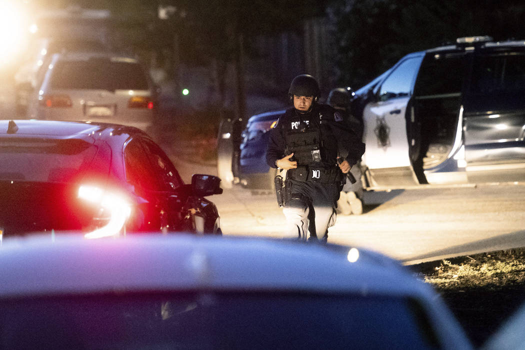 Police work a scene after a deadly shooting at the Gilroy Garlic Festival in Gilroy, Calif., Su ...