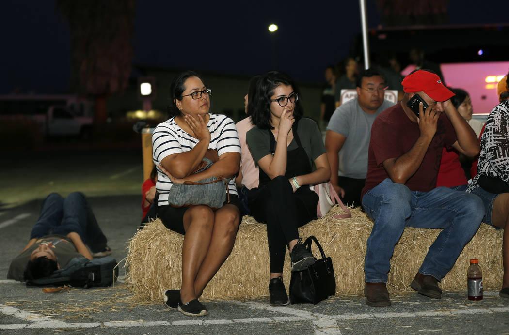 Ana Lilia Cano, left, with daughter Paulina Perez, and Gildardo Leyva, right, wait for relative ...