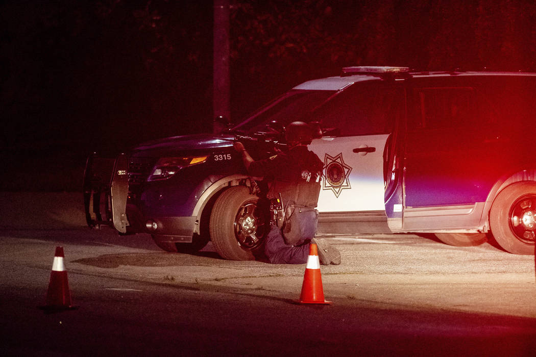 Police stay focused on a target after a deadly shooting at the Gilroy Garlic Festival in Gilroy ...