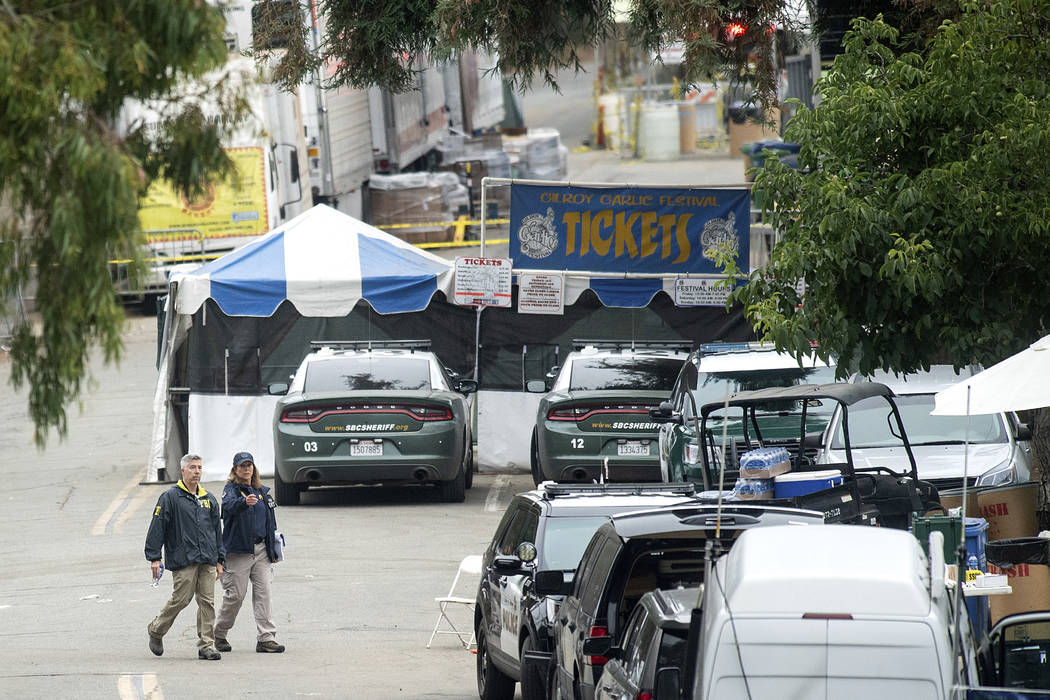 FBI personnel pass a ticket booth at the Gilroy Garlic Festival Monday, July 29, 2019 in Calif. ...