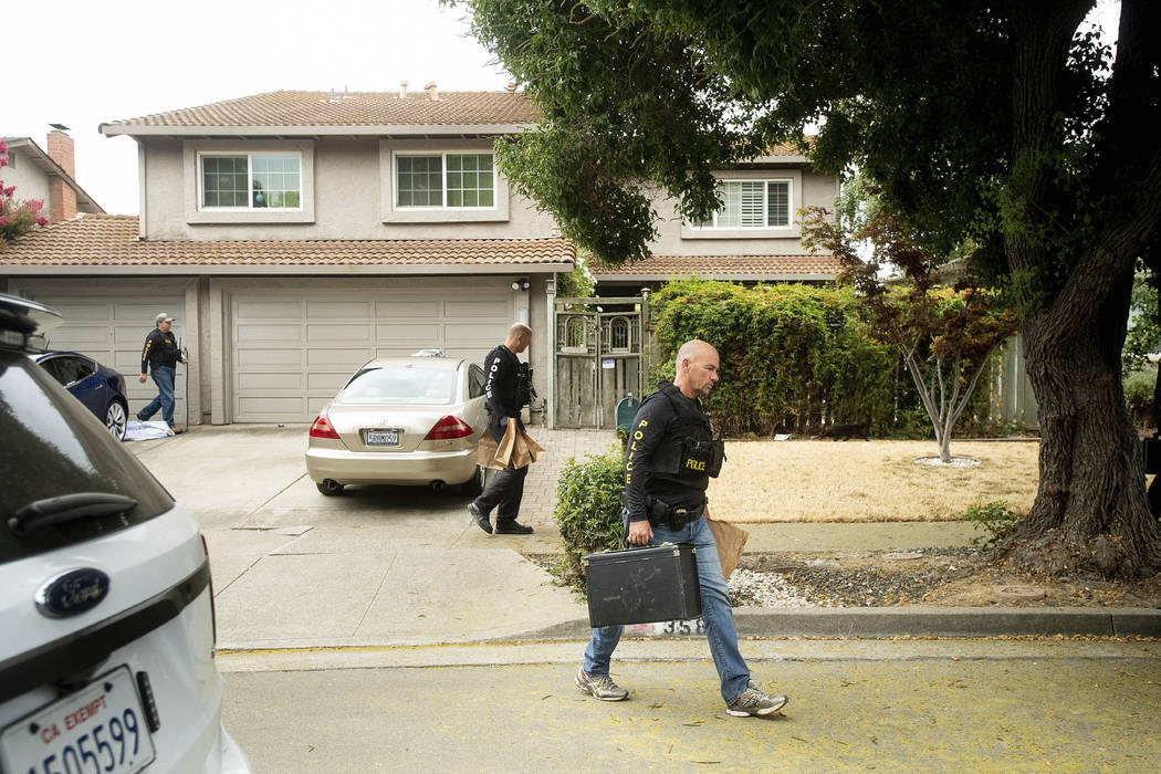 Police officers carry evidence bags from the family home of Gilroy Garlic Festival gunman Santi ...