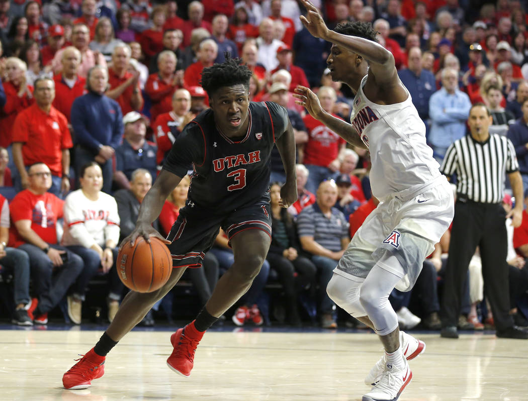 Utah forward Donnie Tillman (3) drives against Arizona guard Dylan Smith during the first half ...