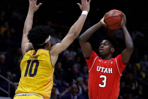 California's Justice Sueing, left, defends against Utah's Donnie Tillman (3) in the second half ...