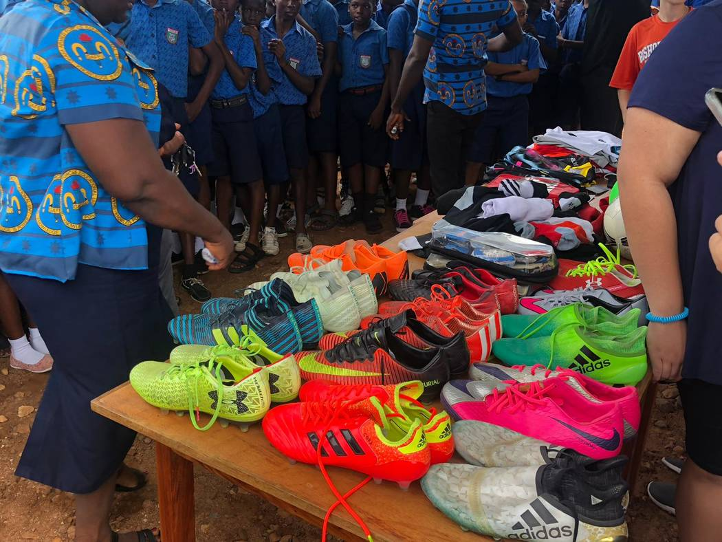 Students at the Kabore School in Ho, Volta Region, Ghana eagerly await selection of soccer shoe ...