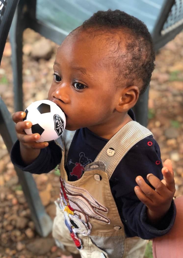 A boy at the Vima Orphanage in Tsibu-Bethel, Volta Region, Ghana kisses a donated Lights mini s ...
