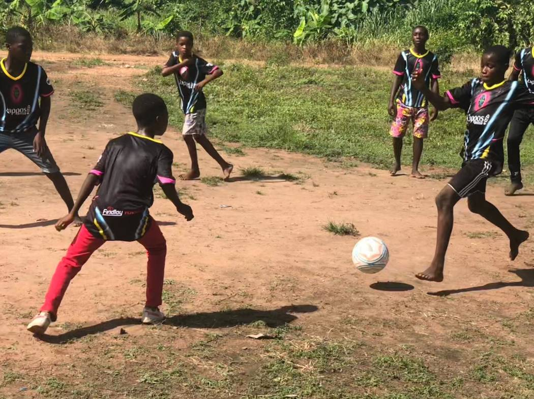 Children of the Vima Orphanage in Tsibu-Bethel, Volta Region, Ghana play a game of soccer after ...