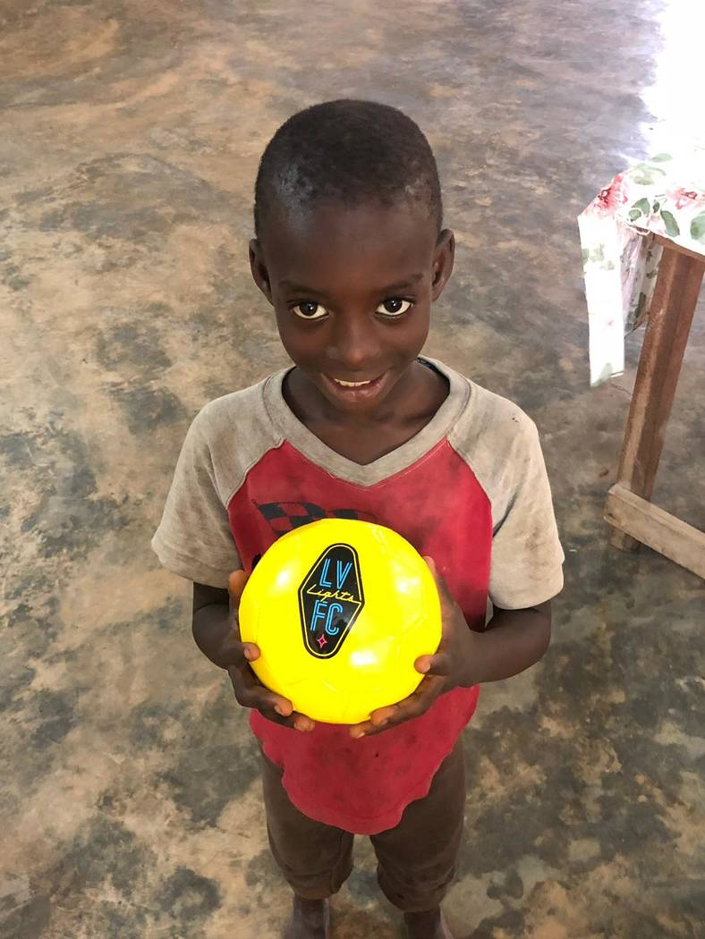 A young man in the town of Nyieve is delighted to receive a Lights soccer ball in June 2019. Ph ...