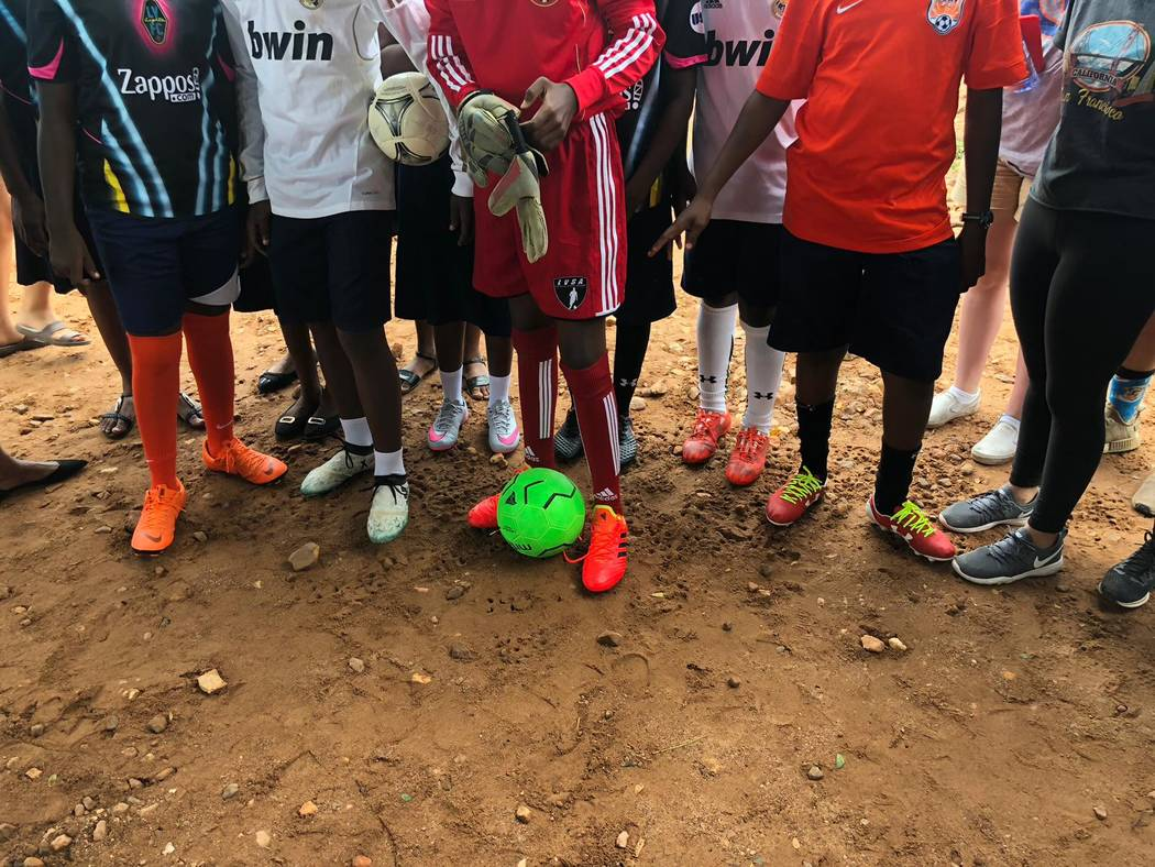 Students at the Kabore School in Ho, Volta Region, Ghana, prepare for a soccer match after Ligh ...