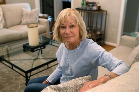 Cancer patient Kim Lauerman poses for a portrait in her home Wednesday, June 26, 2019, in Alpha ...