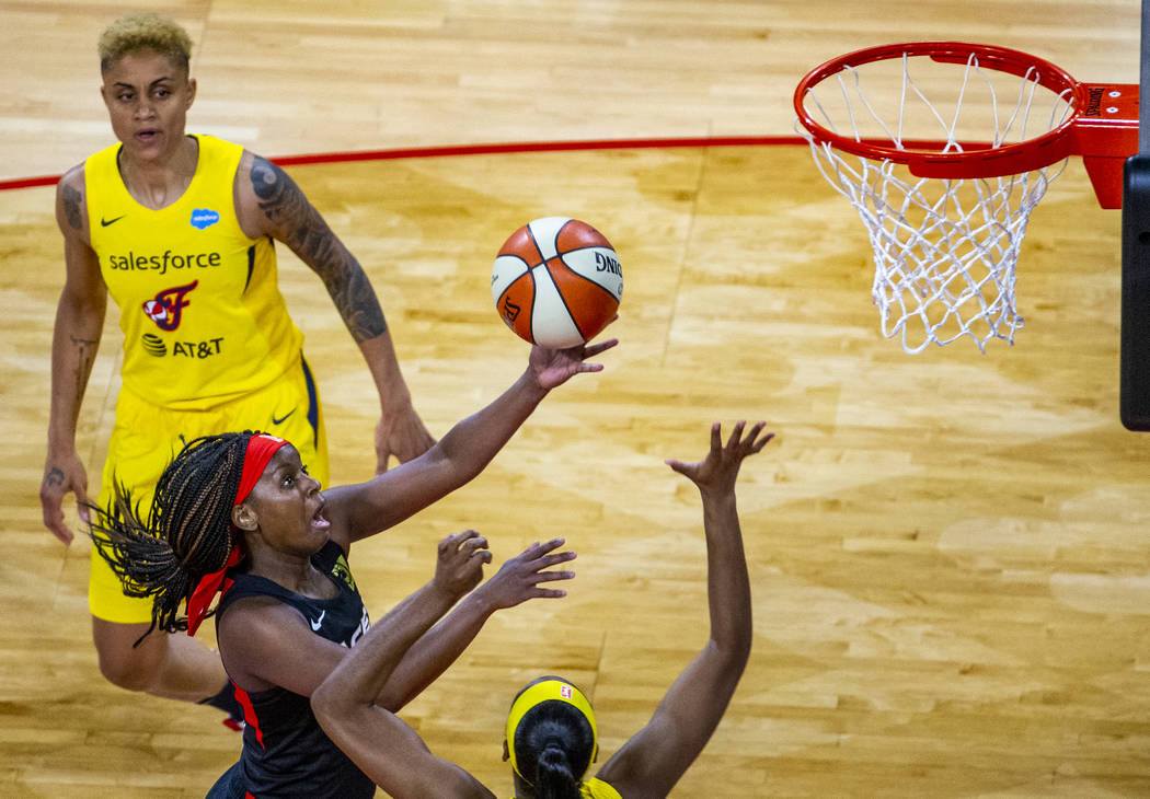 Las Vegas Aces guard Sugar Rodgers (14) rolls off a shot versus the Indiana Fever defense durin ...