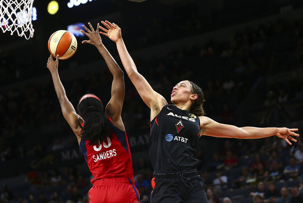 Washington Mystics forward LaToya Sanders (30) blocks a shot from Las Vegas Aces forward Dearic ...