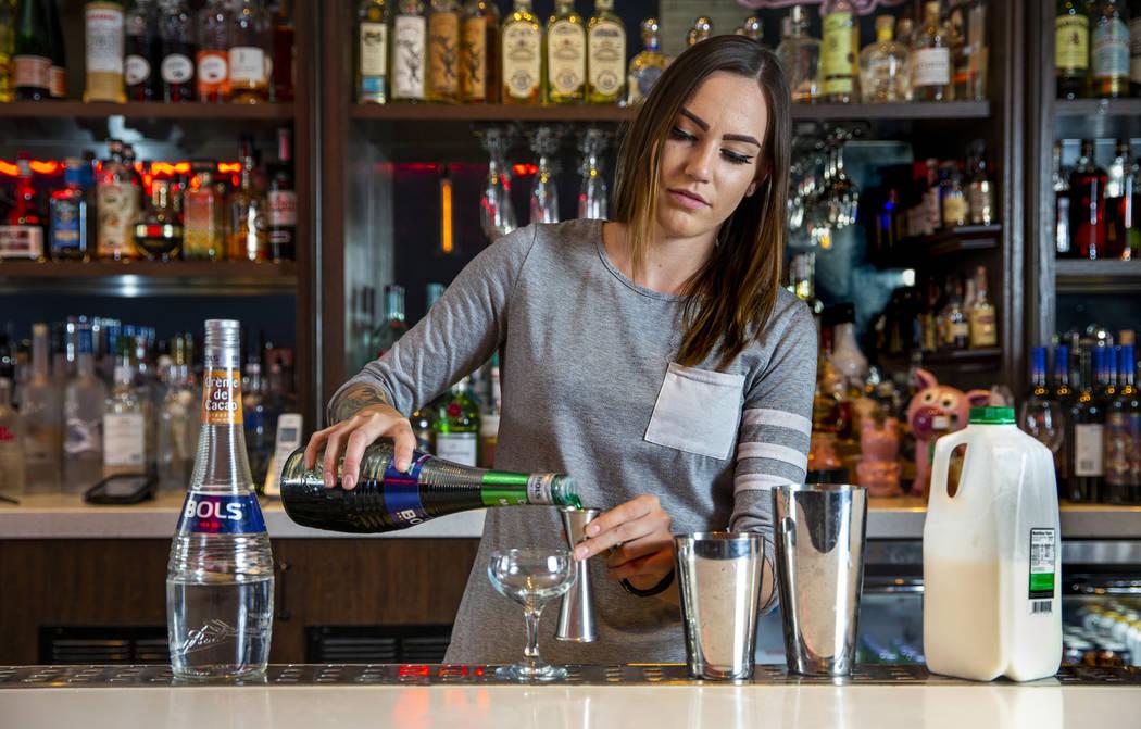 Bartender Sarah Contois at the Smashed Pig prepares a grasshopper drink on Sunday, July 27, 201 ...