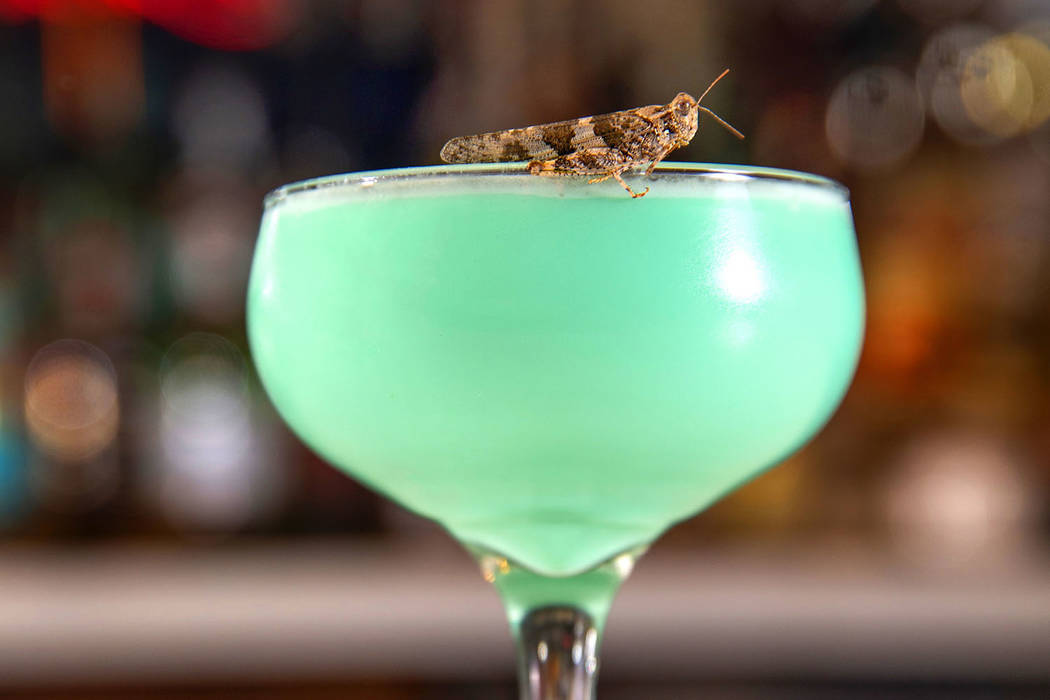 Grasshopper drink with grasshopper on the rim prepared by bartender Sarah Contois at the Smashe ...