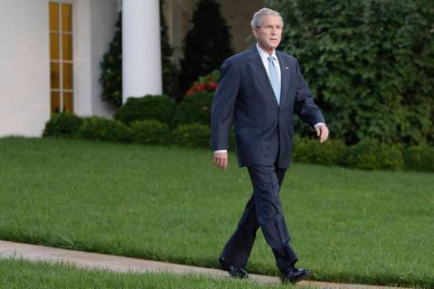 FILE - This Sept. 29, 2008 file photo shows President Bush walking from the Oval Office of the ...