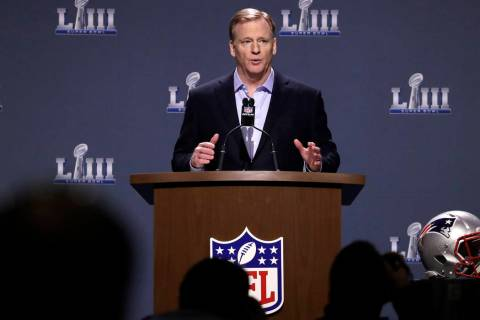 NFL Commissioner Roger Goodell answers a question during a news conference for the NFL Super Bo ...
