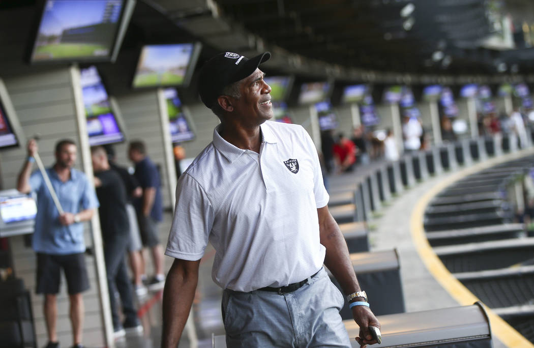 Former Oakland Raiders cornerback Mike Haynes watches his shot during the Raiders Foundation &q ...