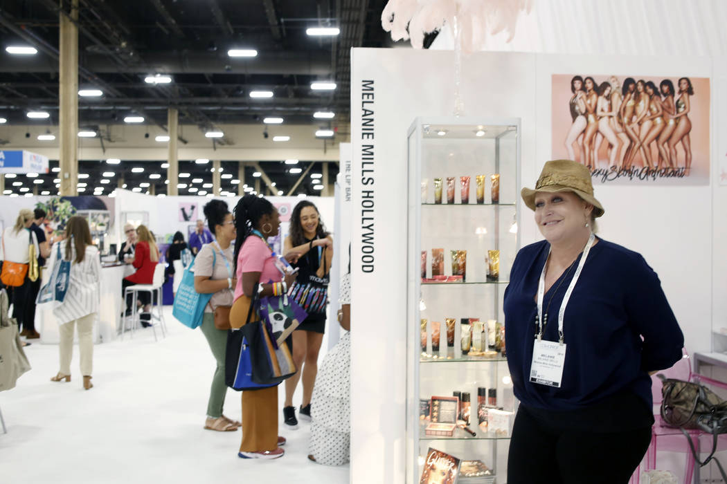 Owner and CEO of Melanie Mills Hollywood, Melanie Mills, right, at her booth at Cosmoprof North ...