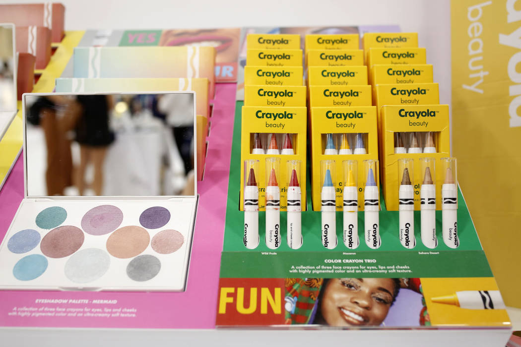 Crayola Beauty displays their vibrant face crayons, lip and cheek crayons and different palette ...
