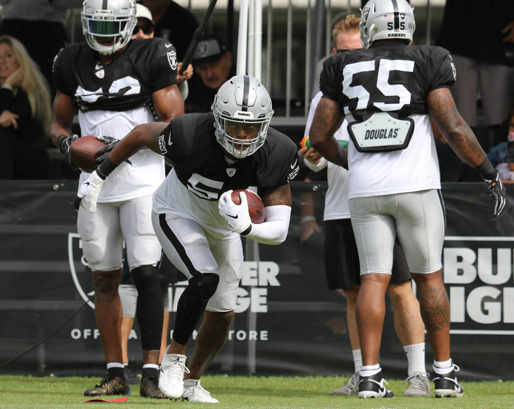 Oakland Raiders inside linebacker Brandon Marshall (54) runs with the football during the NFL t ...