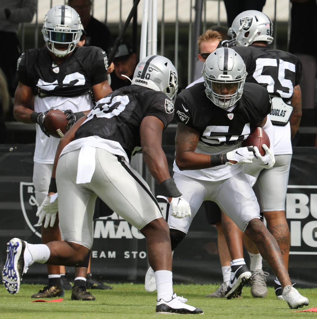 Oakland Raiders linebacker Nicholas Morrow (50) comes in to tackle inside linebacker Brandon Ma ...