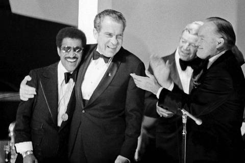 A May 25, 1973, file photo, shows President Richard Nixon embracing Sammy Davis Jr. during fest ...