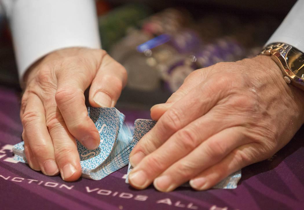 A dealer shuffles cards at the blackjack table at SLS Las Vegas on Thursday, May, 30, 2019, in ...