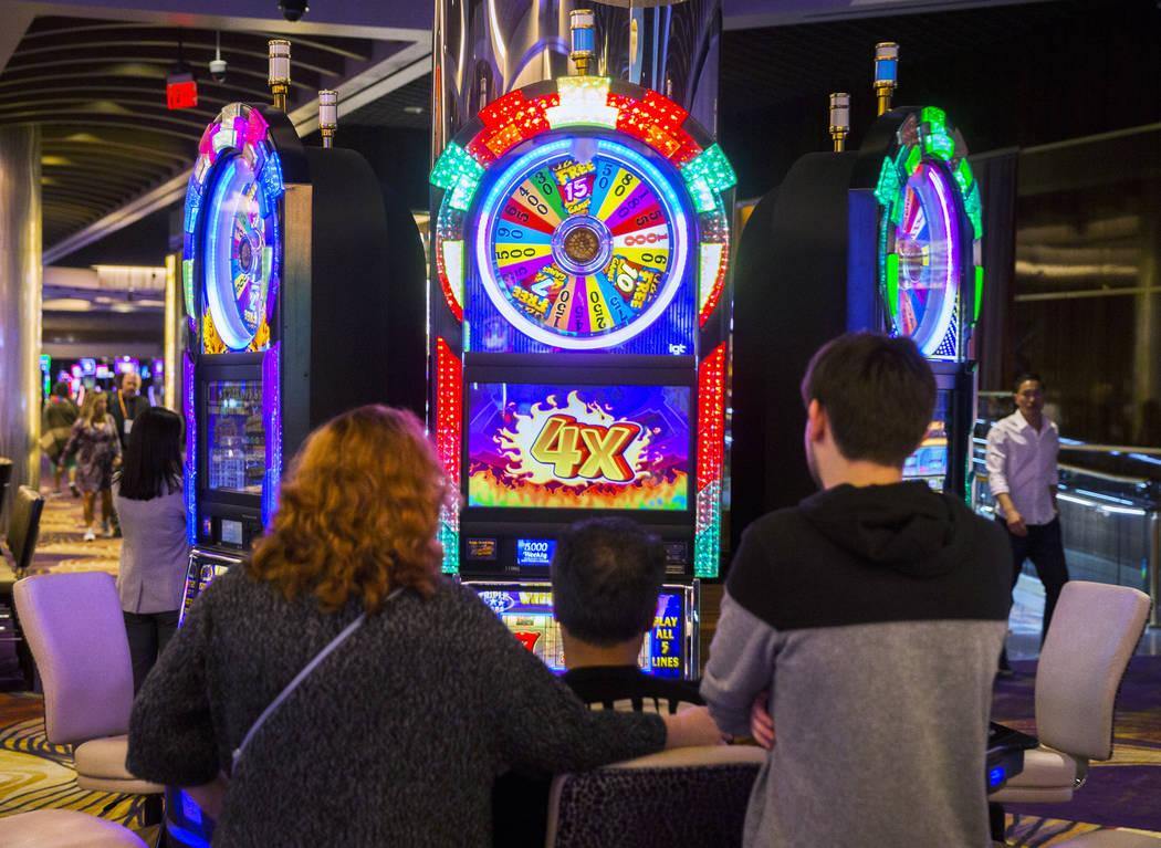Gamblers play slots at SLS Las Vegas on Thursday, May, 30, 2019, in Las Vegas. (Benjamin Hager/ ...