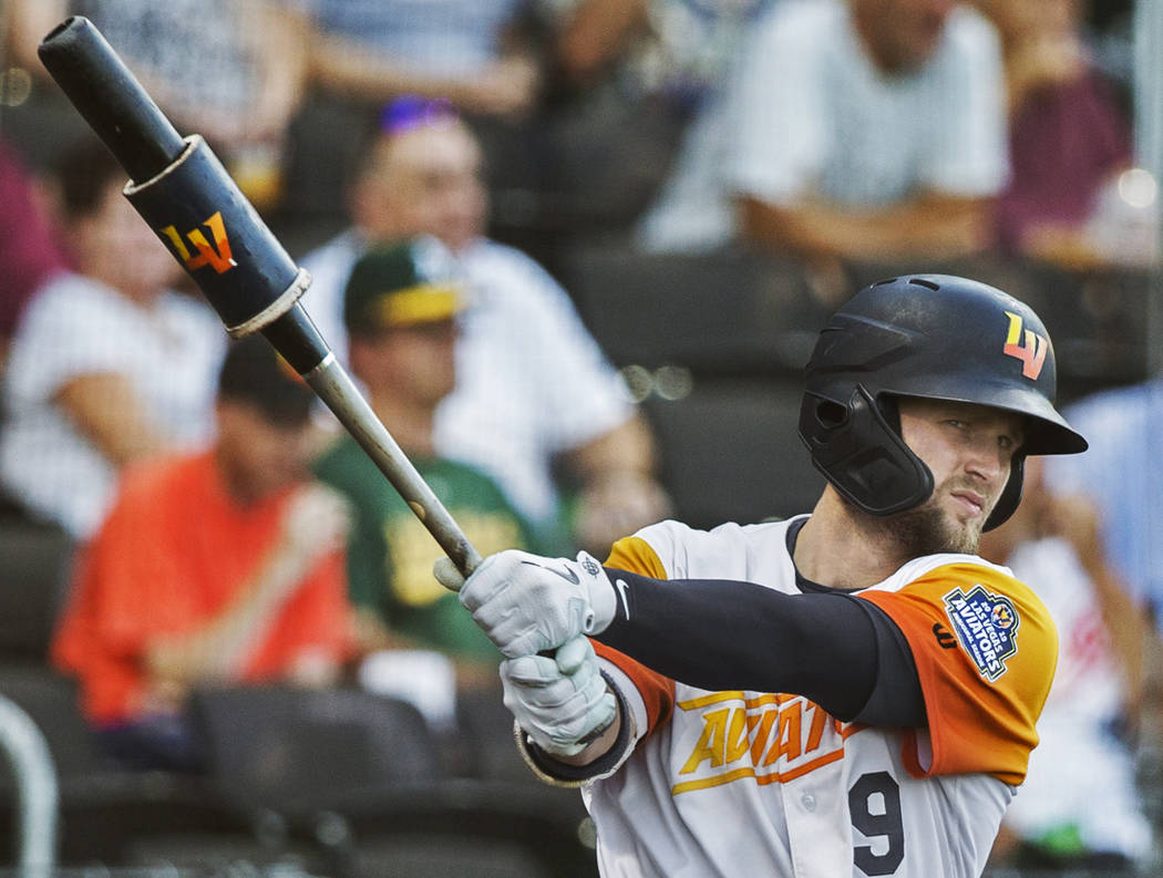 Las Vegas Aviators first baseman Seth Brown (9) warms up in the on deck circle in the bottom of ...